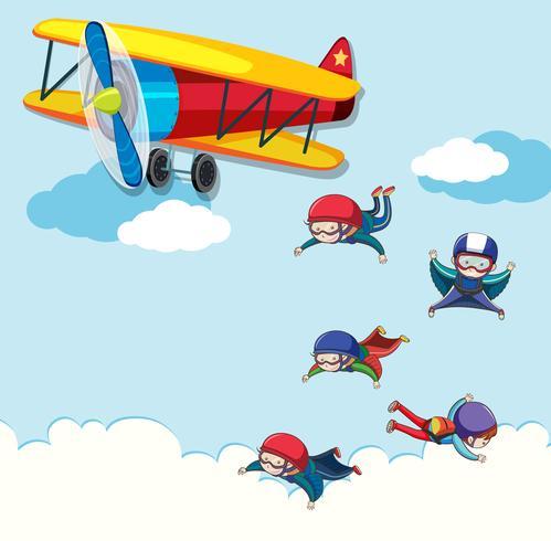 Personas saltando de un avión