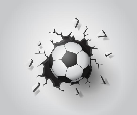 Football sur le mur cassé.