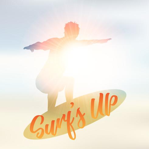 Silhouette of a surfer on a defocussed summer background