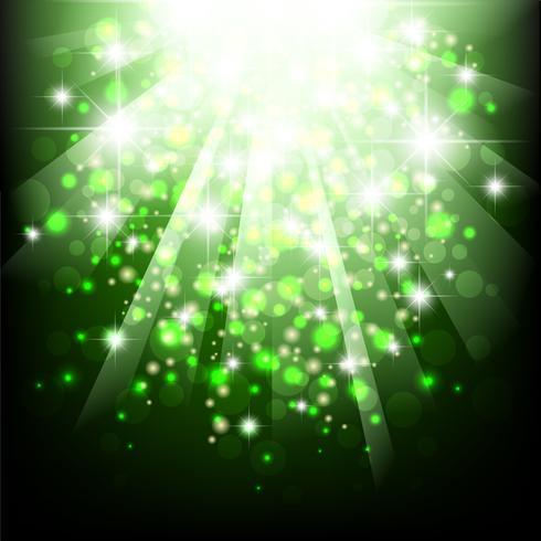 grön solljusburst. grön bakgrund med bokeh lampor.