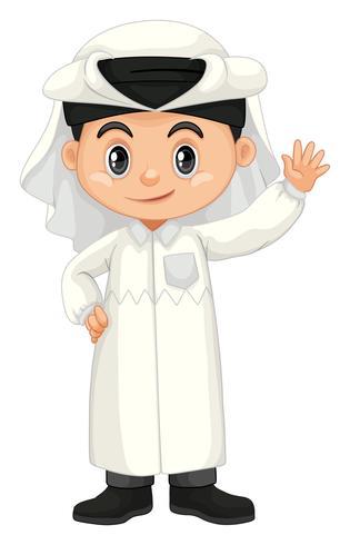 Jongen in Qatar kostuum zwaaiende hand