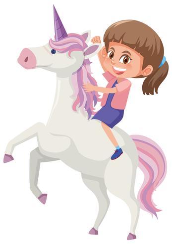 Una niña montando unicornio