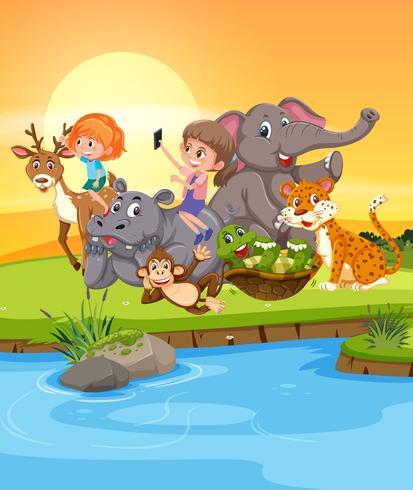 Meisjes spelen met wilde dieren