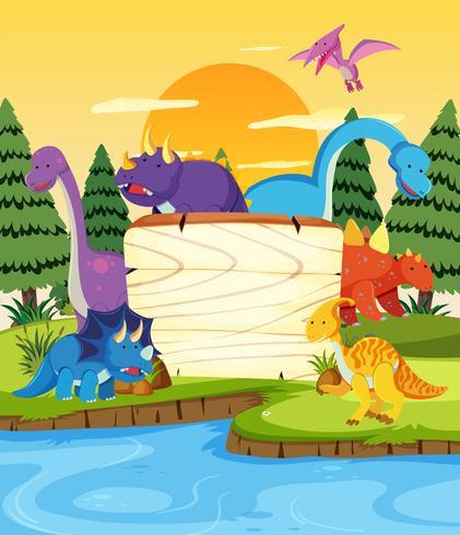 Många dinosaur på träbräda