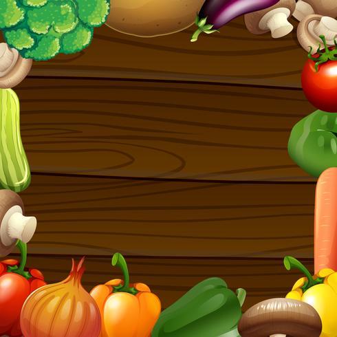 Vegetables border on wooden frame