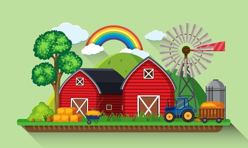 Dos graneros rojos y molino de viento en la granja