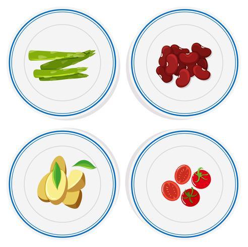 Olika grönsaker på runda tallrikar