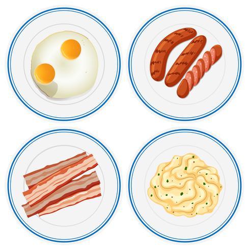 Frühstücksset auf vier Tellern