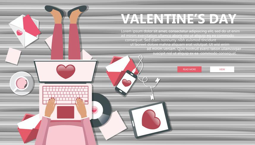 Valentine's day banner for websites. Girl sitting on wooden floor and holding lap top in her lap