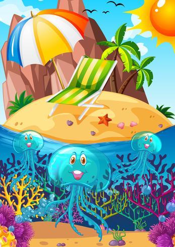 Escena del océano con medusas bajo el agua