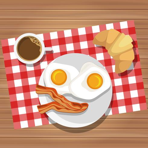 Frukost av stekt ägg och bacon med kaffe och smörrulle