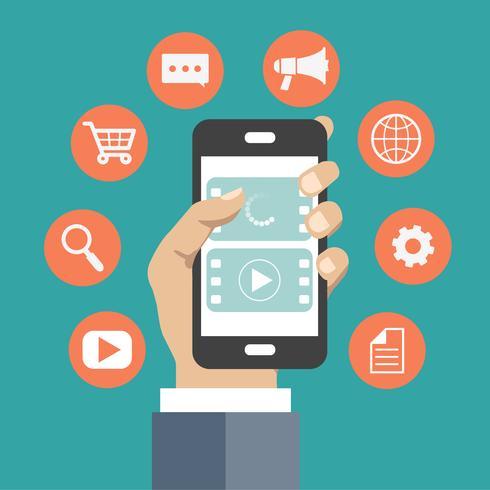 Concept d'application mobile. Main tenant le téléphone avec des icônes autour d'elle