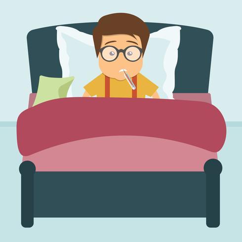 Ragazzo malato sdraiato nel letto con il termometro in bocca