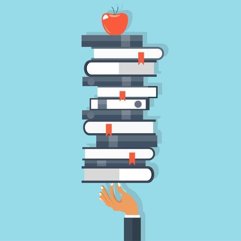 Concept d'éducation et de connaissance. Main tenant un tas de livres avec pomme sur le dessus