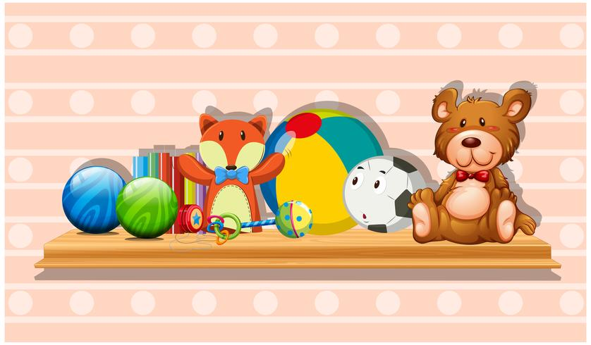 Many cute toys on wooden board