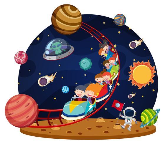 Niños montando espacio en montaña rusa