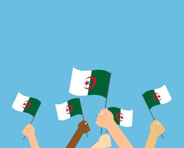 Vector Illustration von den Händen, die Algerien-Flaggen halten, die auf blauem Hintergrund lokalisiert werden