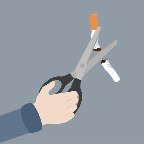 hand Scissors cutting a cigarrette
