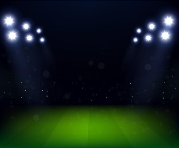 Estádio de futebol à noite com holofotes