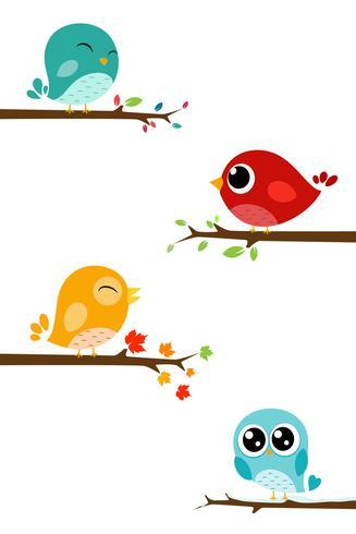 Gli uccelli cantano sul ramo