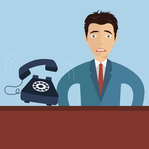 Orolig affärsman med ringtelefon