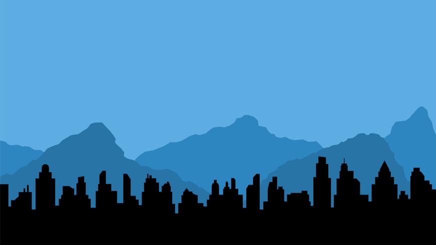 Blue mountains and black silhouette of city