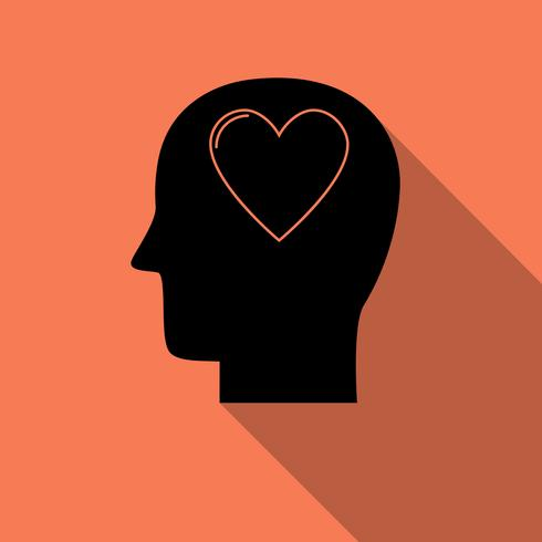 Testa umana con l'icona del cuore, simbolo di amore con una lunga ombra