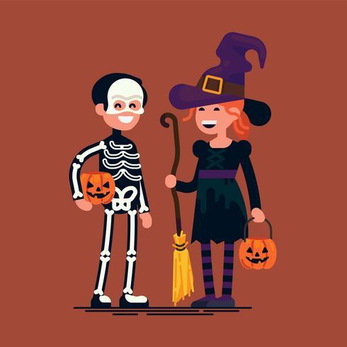 Barn bär trick eller behandla halloween kostymer