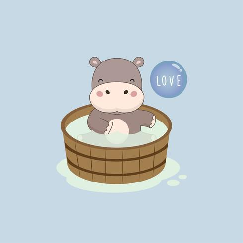 Happy hippo in the wood bath tub.