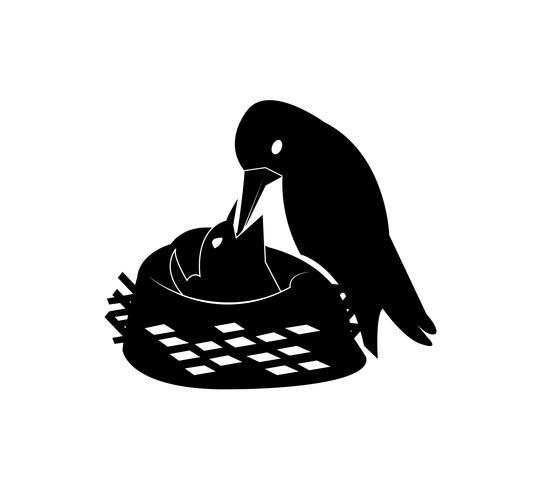 Pássaro alimentando os pequeninos