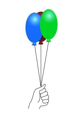 Mano che tiene palloncini colorati
