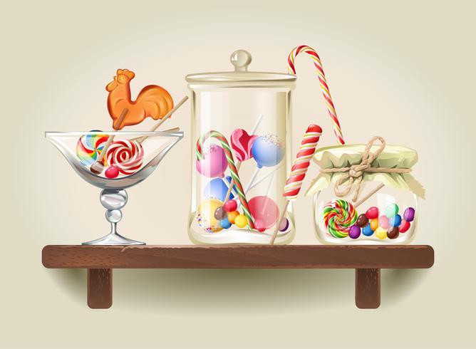 Bonbons en pots de verre sur une étagère en bois