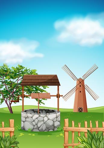 Szene mit Windmühle und Brunnen im Bauernhof