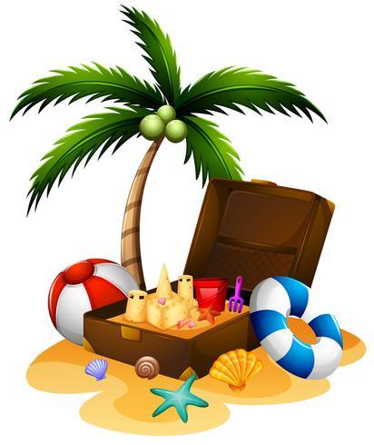 Sommerthema mit Koffer und Sandburg
