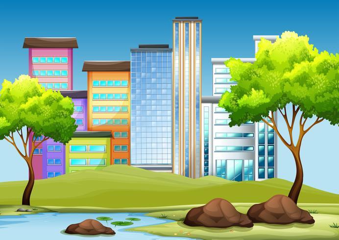 Byggnader och parkera i staden vektor