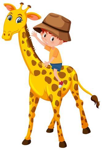 En pojke som rider giraff