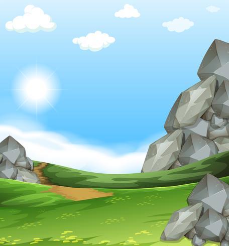 Escena de la naturaleza con campo y piedras
