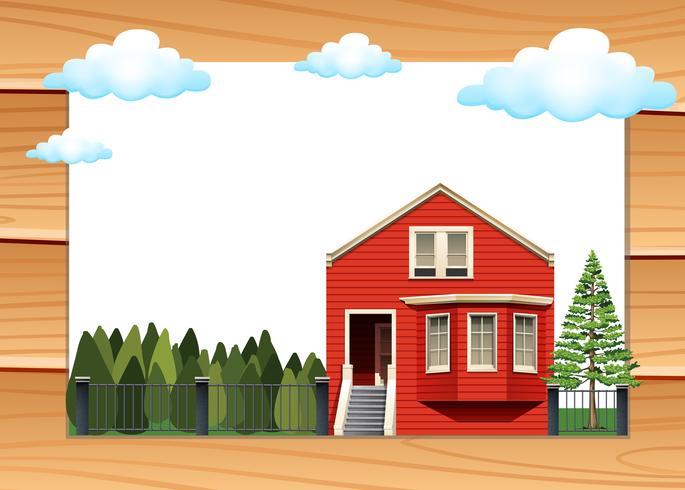 Maison rouge sur le mur en bois