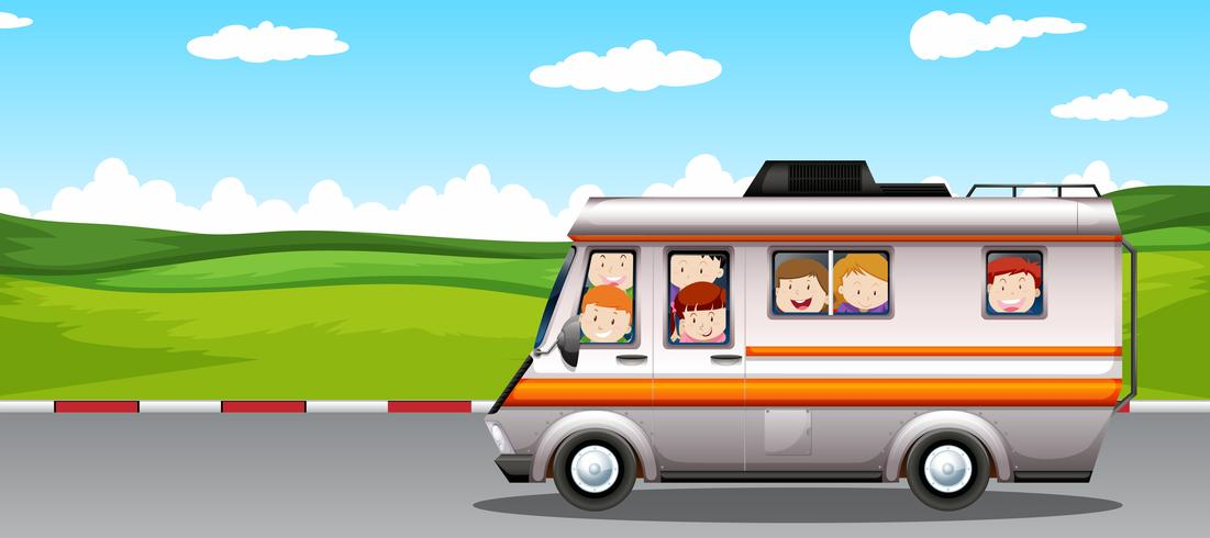 Children riding on camper van