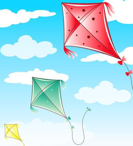 Tre drakar som flyger i blå himmel