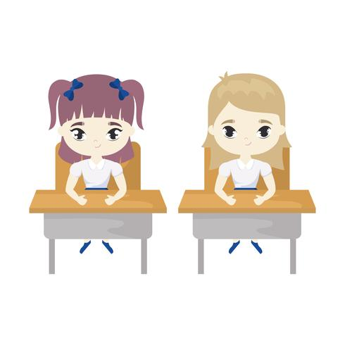 little student girls seated in school desks