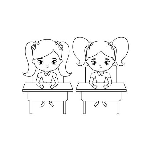 little student girls seated in school desks