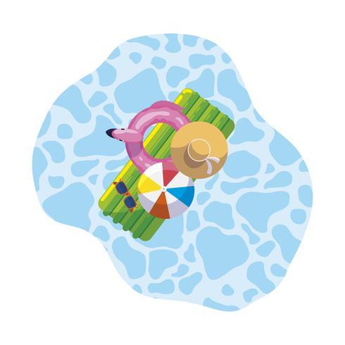 Almohadilla flotante de verano con globo y sombrero flotando en la piscina