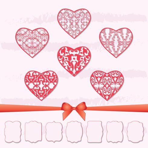 Eine Reihe von Herzen und eine Sammlung von Rahmen in verschiedenen Formen durch Ausschneiden von Papier.