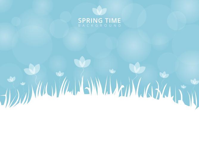 Temps de printemps et de fleurs avec bokeh sur fond bleu avec la place pour le texte.