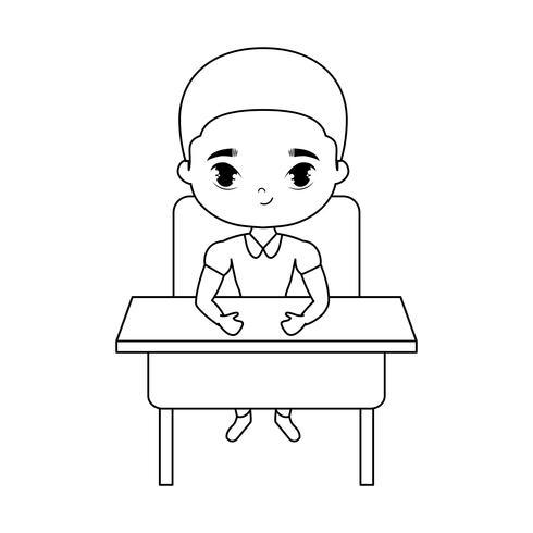 niño pequeño estudiante sentado en el escritorio de la escuela