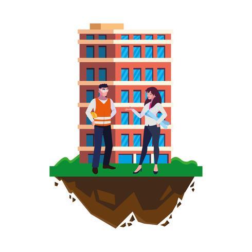 männlicher Erbauererbauer mit Fraueningenieur und -gebäude