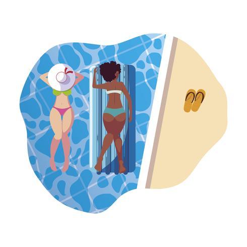 vackra interracial flickor med flottörmadrass i vatten