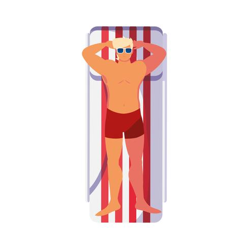 young man with swimsuit in tanning mat