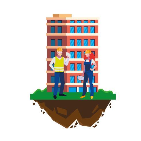 couple de constructeurs constructeurs ouvriers avec bâtiment
